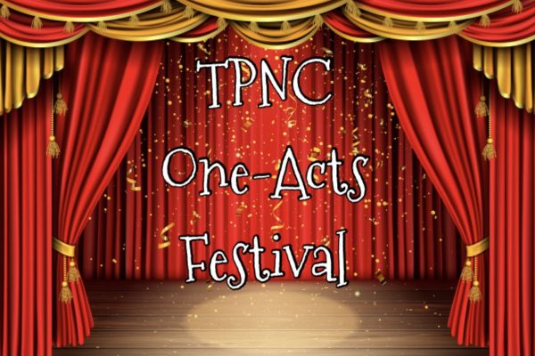 "The words ""TPNC One-Act Festival"" are written in front of a theater stage curtain"